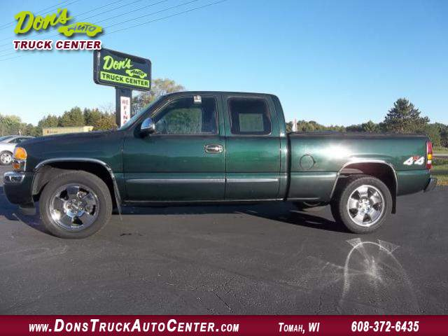 Title #www.dealerpacim.net/vehicle_images/widonsauto/0010043/2006 GMC-SIERRA-SLE-4X4- X CAB-DK GREEN-S B-100K 002.JPG
