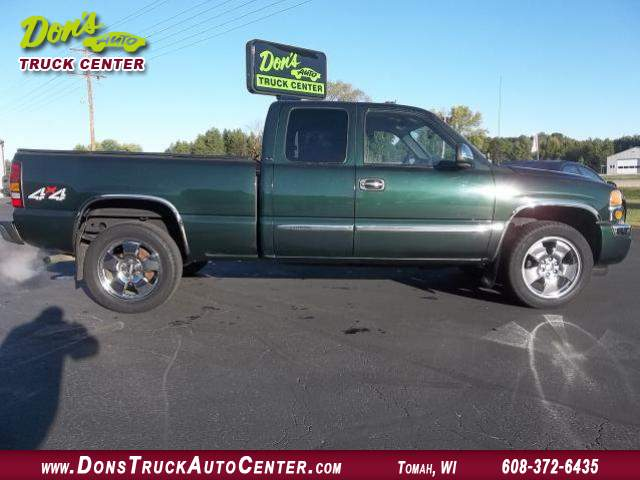 Title #www.dealerpacim.net/vehicle_images/widonsauto/0010043/2006 GMC-SIERRA-SLE-4X4- X CAB-DK GREEN-S B-100K 006.JPG